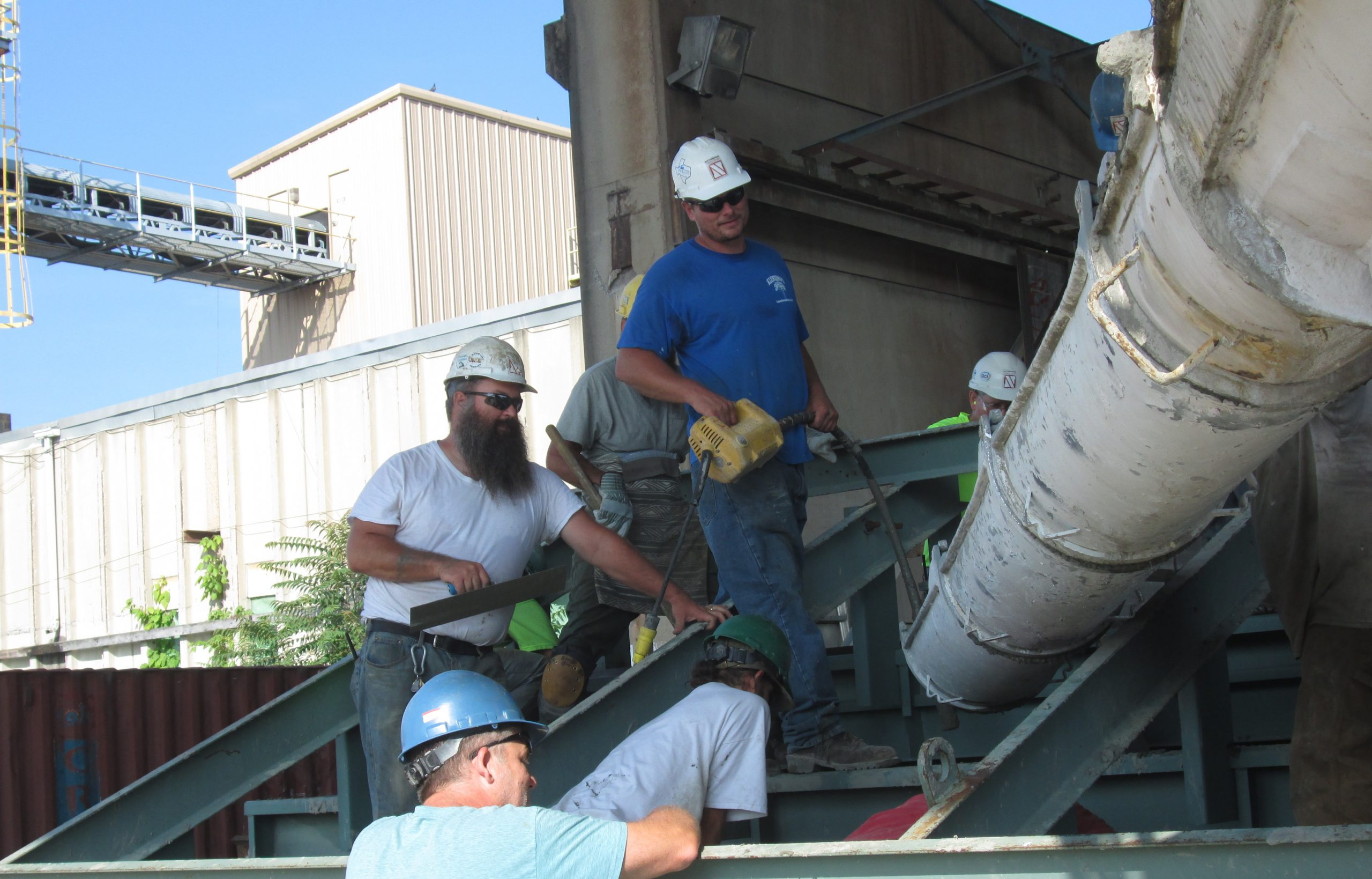 Nitterhouse employees pouring concrete into stadium riser molds