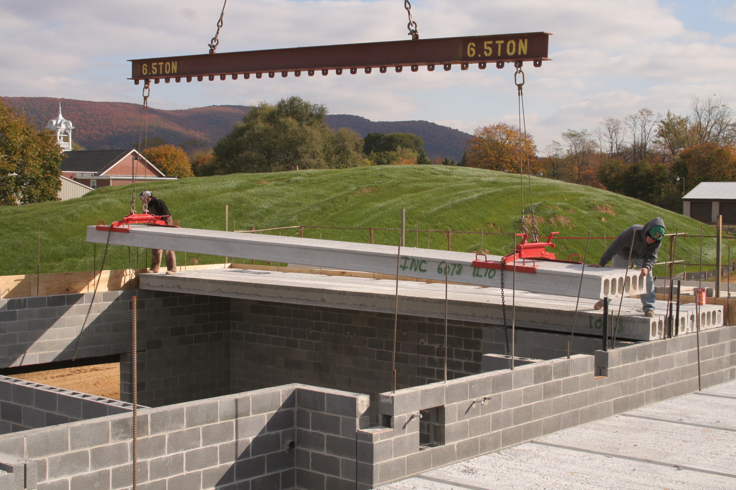 Hollowcore being placed on top of concrete blocks during construction